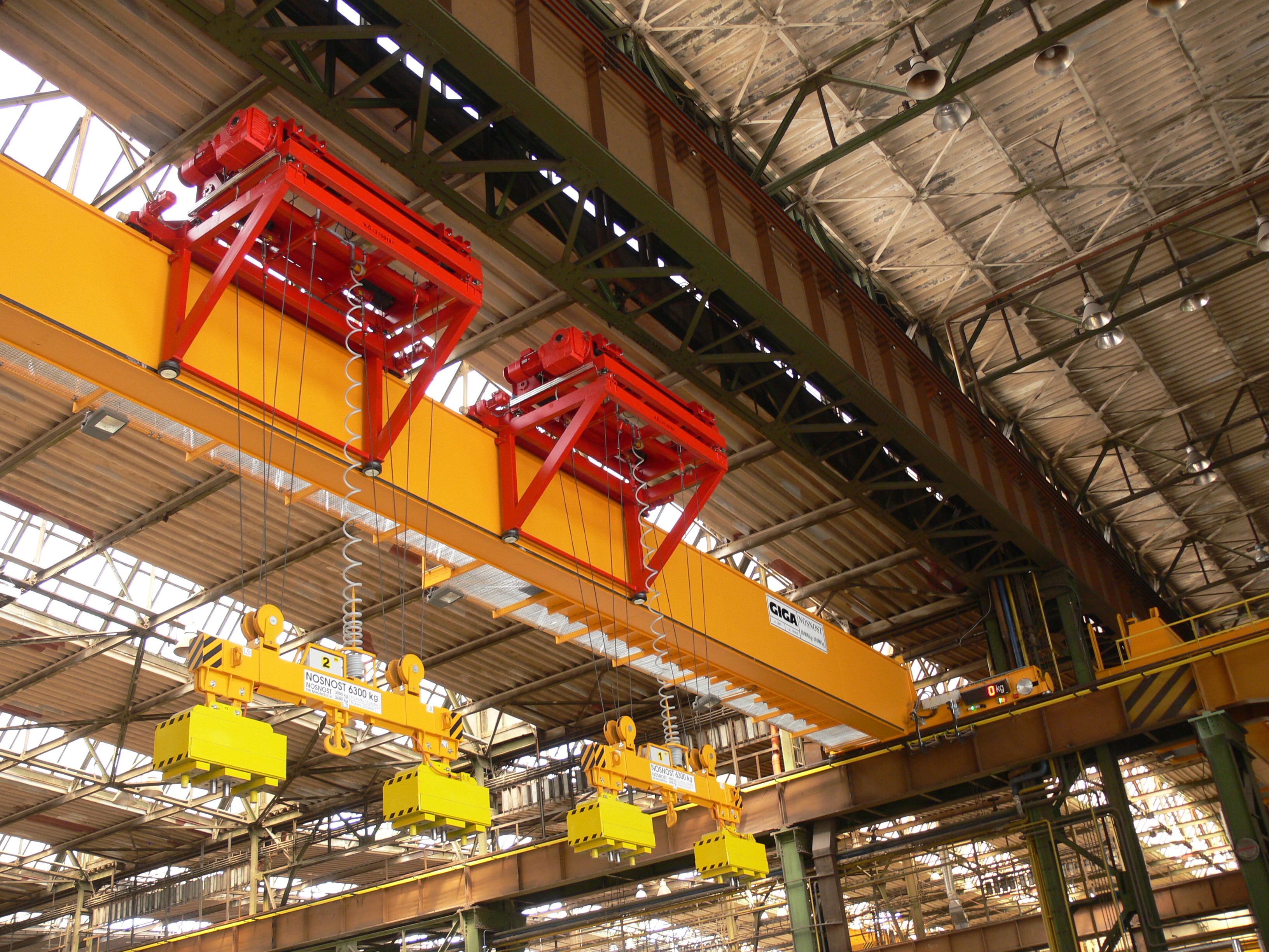 Delivery of special bridge cranes with cantilever hoists for the NYPRO metallurgical storehouse